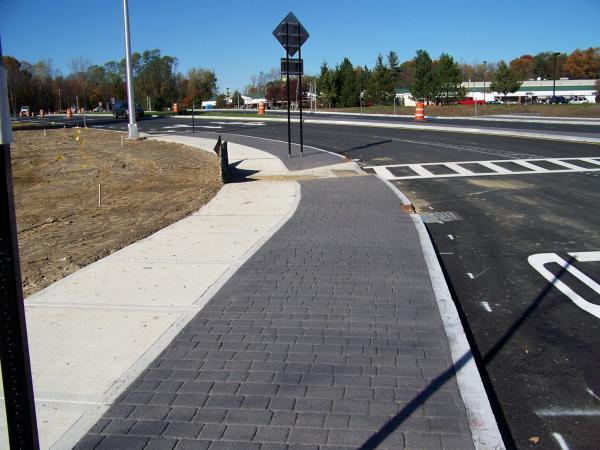 Stamped Asphalt Profile Curb To Sidewalk Albany Ny